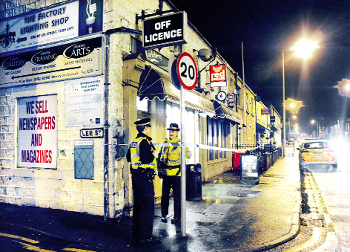 Police outside McGuires, which was raided by Ben Smith