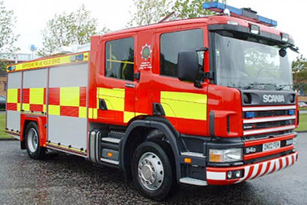 Fire crews tackle garden bonfire close to Colne house