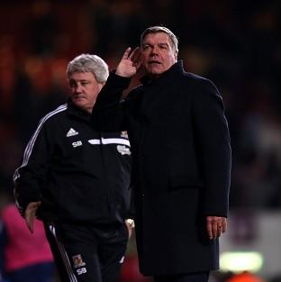 West Ham manager Sam Allardyce puts his hand to his ear to listen to t