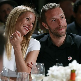 Gwyneth Paltrow and Chris Martin are said to be enjoying a family holiday despite the split