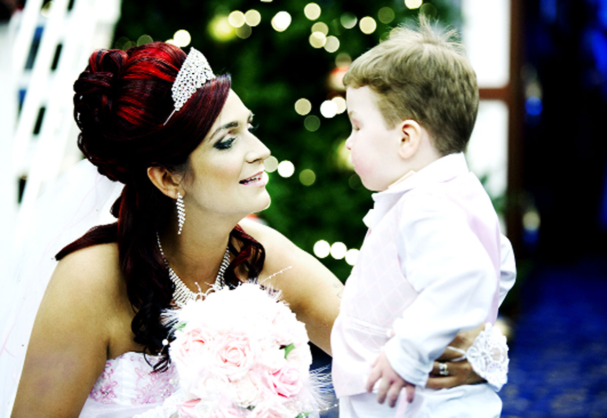 Carson Hartley with his mum Kirsty on her wedding day. Kirsty and Carson's dad Damian married recently so that Carson could attend the ceremony