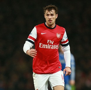 Arsenal midfielder Aaron Ramsey, pictured, is out with a thigh injury