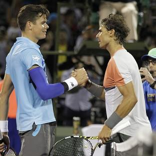 Burnley and Pendle Citizen: Rafael Nadal, right, overcame a scare to see off Milos Raonic at the Sony Open (AP)
