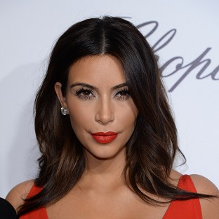 Kim Kardashian is used to seeing herself with make-up on