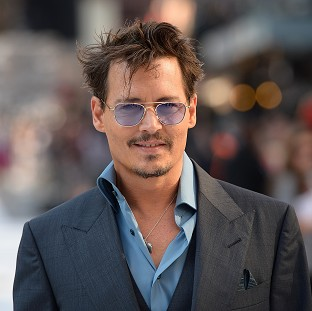 Johnny Depp previewed his movie at CinemaCon