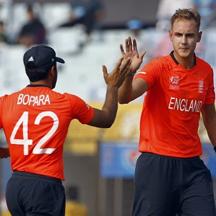 Stuart Broad, right, celebrates with Ravi Bopara after taking the wicket of Michael Swart (AP)