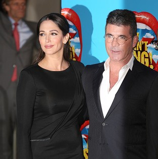 Simon Cowell says he and Lauren Silverman are coping well with baby Eric