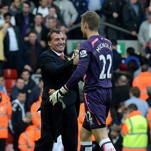 Burnley and Pendle Citizen: Liverpool goalkeeper Simon Mignolet, right, has hailed the team spirit created by manager Brendan Rodgers, left
