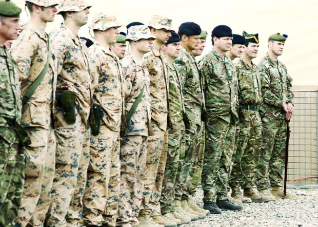 Burnley and Pendle Citizen: Soldiers on parade at the Task Force Helmand merger ceremony at Camp Bastion