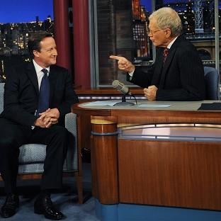 David Letterman, seen here with Prime Minister David Cameron, has announced he is to retire