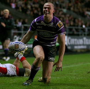 Joe Burgess marked his Challenge Cup debut with four tries as Wigan beat Dewsbury on Friday night