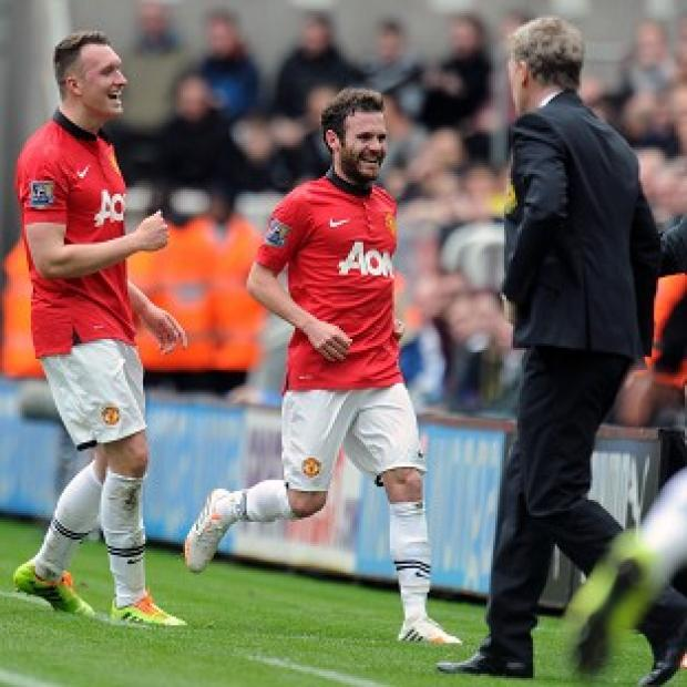 Burnley and Pendle Citizen: Juan Mata, centre, bagged a brace against Newcastle