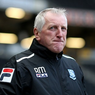 Ronnie Moore, pictured, was suspended by Tranmere in February