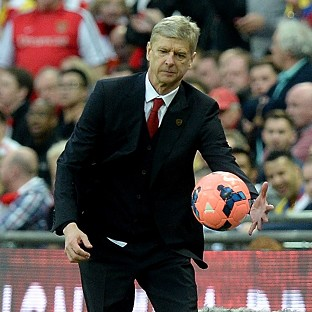 Arsenal manager Arsene Wenger praised the character shown by his side in their victory over Wigan