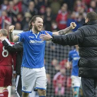 Burnley and Pendle Citizen: Stevie May, left, celebrates with manager Tommy Wright after the final whistle