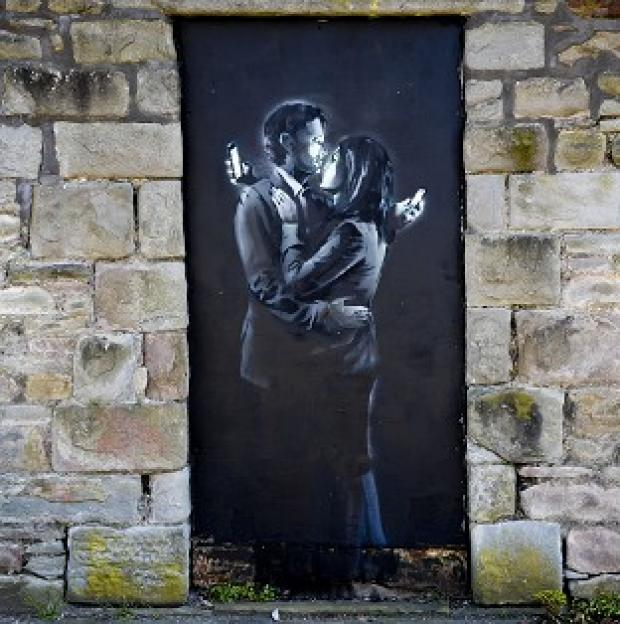 Burnley and Pendle Citizen: David Stinchcombe, a youth centre leader, moved the Banksy artwork from a wall in Clement Street, Bristol