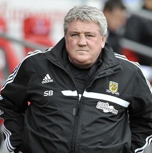 Hull boss Steve Bruce, pictured, believes Arsenal manager Arsene Wenger is
