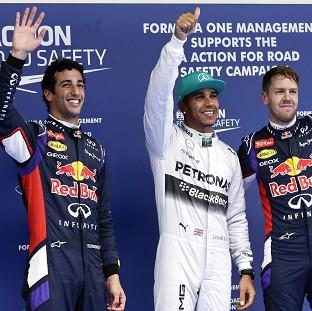 Burnley and Pendle Citizen: Lewis Hamilton, centre, beat both Red Bulls to pole in China (AP)