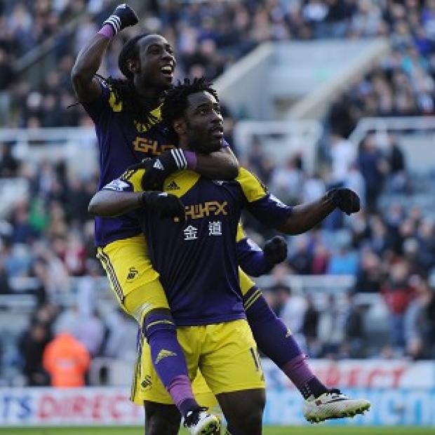 Burnley and Pendle Citizen: Wilfried Bony, right, celebrates scoring the winner