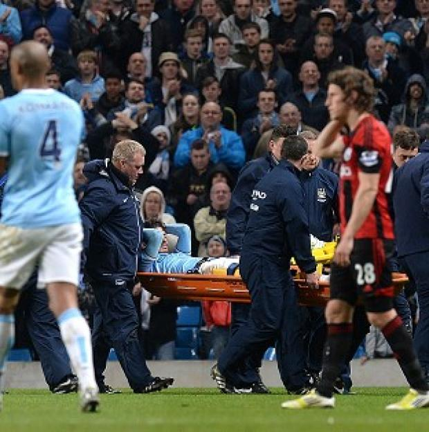 Burnley and Pendle Citizen: David Silva was carried off on a stretcher at the Etihad