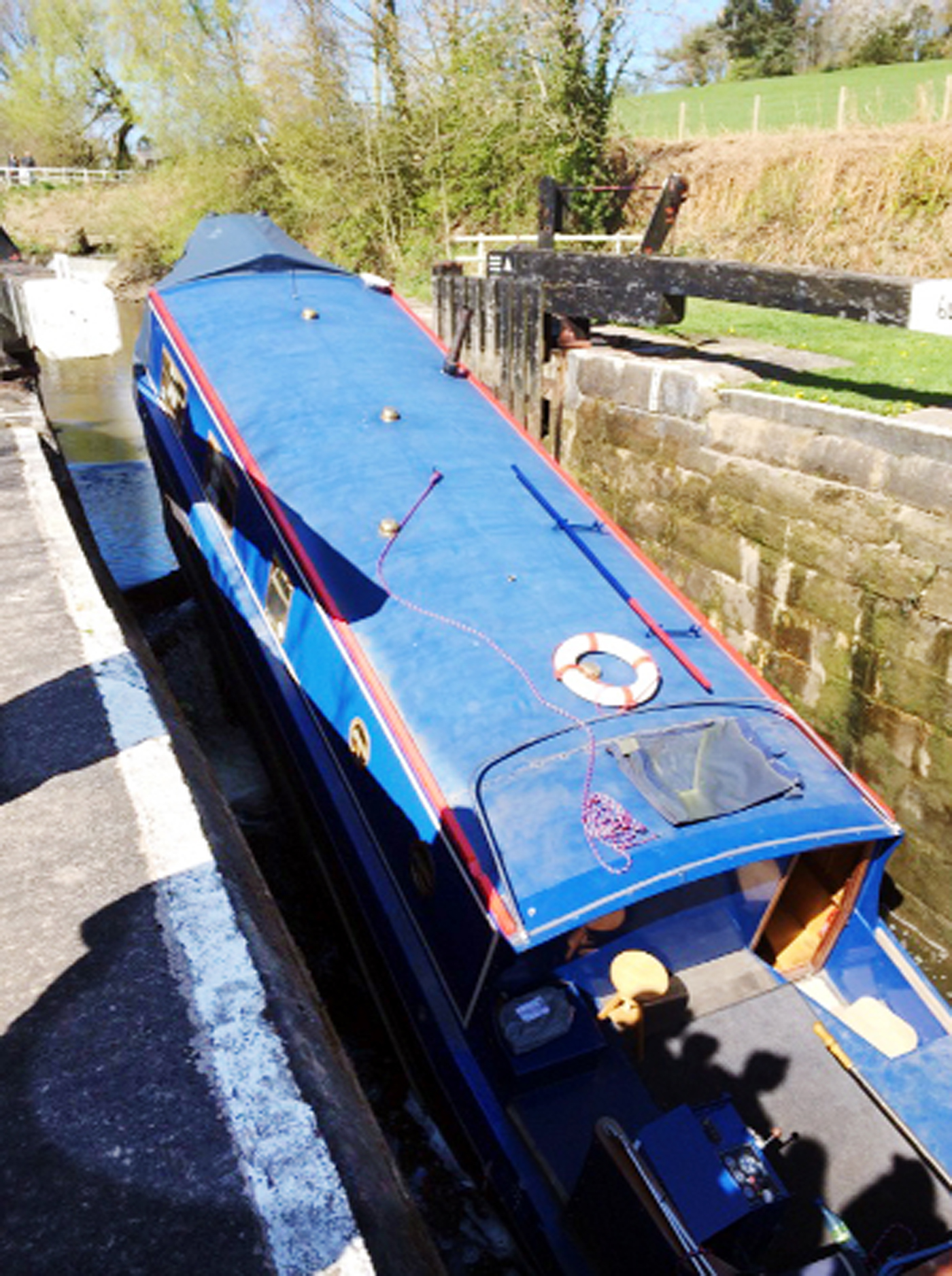 A narrowboat wedged in a canal lock between Chorley and Wheelton