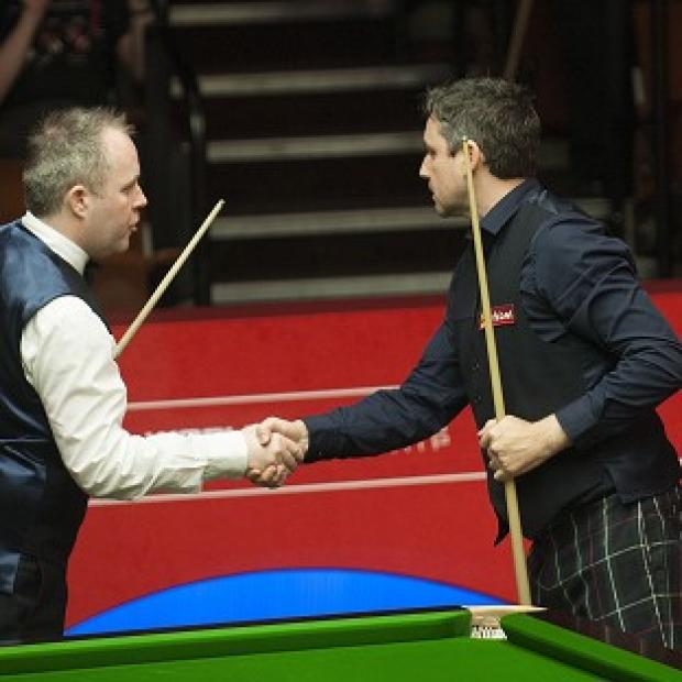 Burnley and Pendle Citizen: John Higgins, left, and Alan McManus shake hands after their match