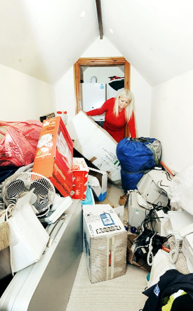 Burnley and Pendle Citizen: Julie Eastham in her Woodlea Chase home where she has suffered flooding after work on a boiler