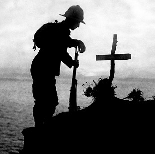 A soldier pays his respects at the grave of a colleague near Cape Helles, where the Gallipoli landings took place
