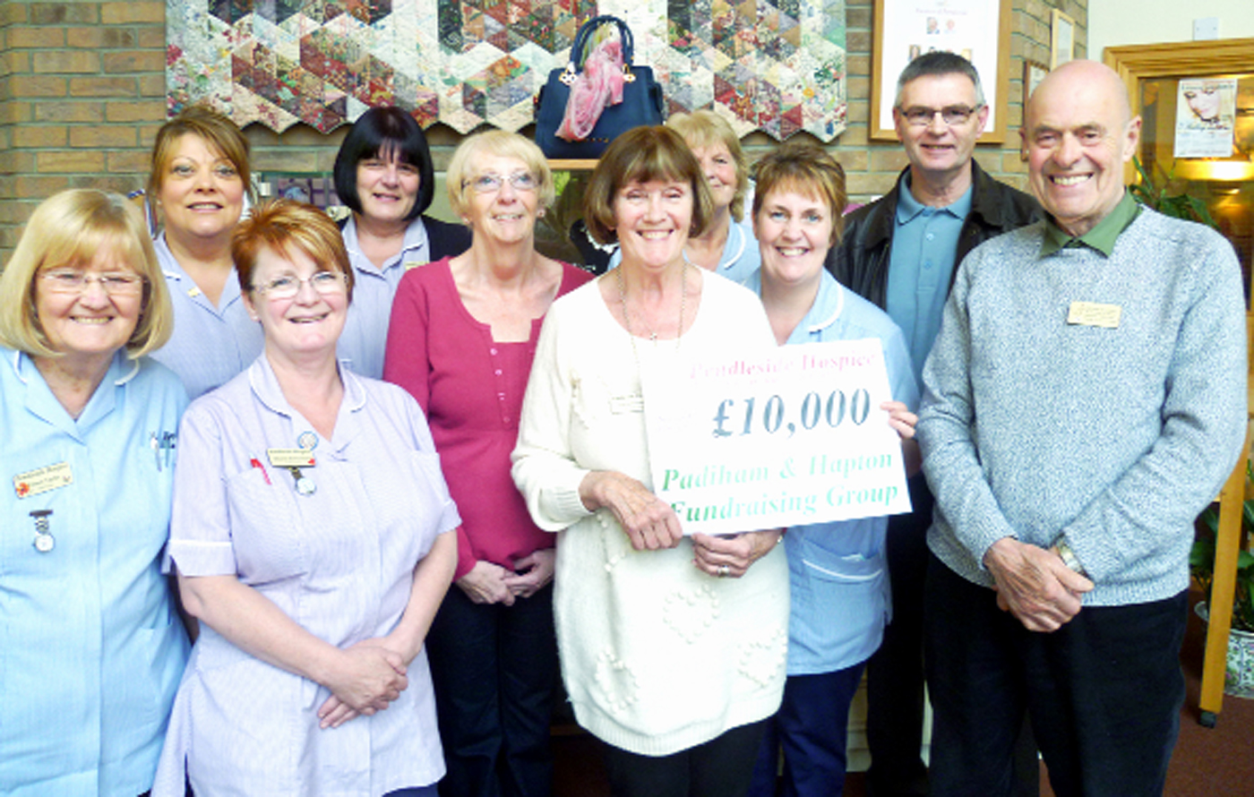 Fundraisers for Pendleside Hospice cheque in with fantastic £10,000