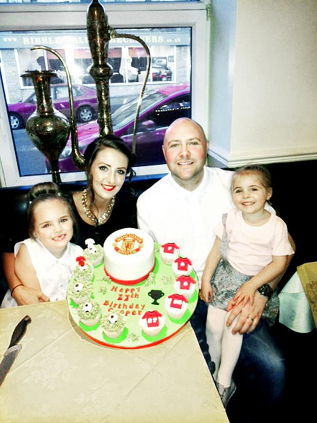 Burnley and Pendle Citizen: Tom and Tammy Cooper with daughters Ziani, three, and Tienna, six