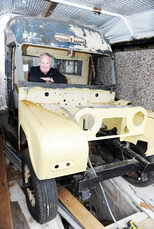 Alan with the ambulance which is undergoing restoration