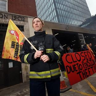 Burnley and Pendle Citizen: Firefighter Jes Bate at Euston fire station in London as firefighters staged a five hour strike in a row over pensions