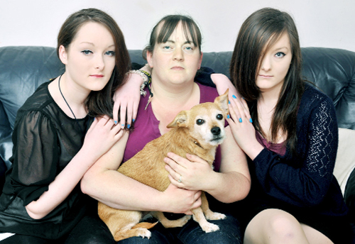 Becky  Morrisey, with twin nieces Chloe and Alicia Morrisey and pet dog Deef after their traumatic experience with the burglary carried out as they were sleeping