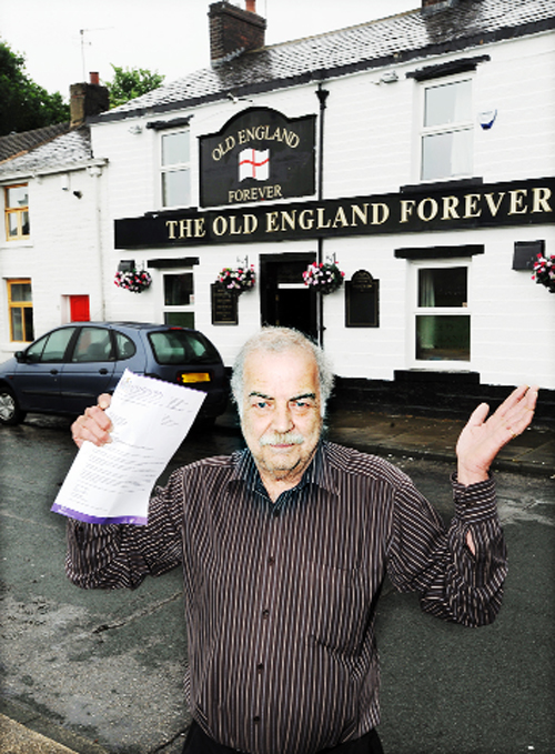 Landlord John Hodgkiss outside the Old England Forever with the council warning letter he received after his previous  successful festival