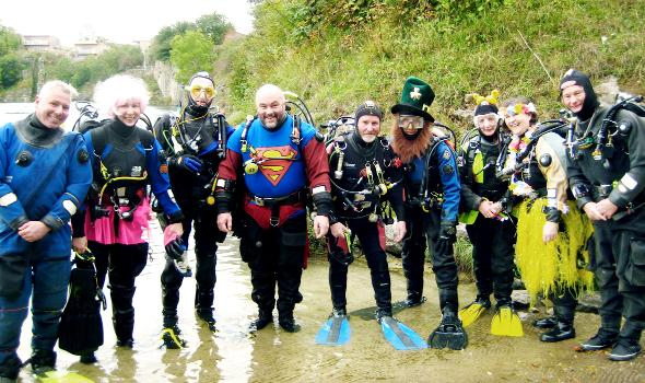 Divers prepare for an underwater stunt to raise money in memory of Duncan Priestley