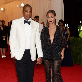 Jay Z and Beyonce go on the run in a spoof film trailer to promote their tour