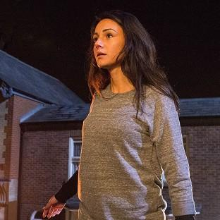 Coronation Street barmaid  Tina McIntyre, played by Michelle Keegan, as she plunges to the cobbles from the balcony of the builders yard after a dramatic confrontation with her k