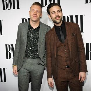 Macklemore (left) apologised for any fuss caused by his costume at a recent gig