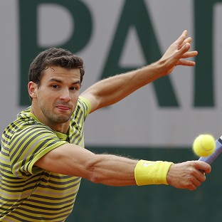 Grigor Dimitrov, pictured, was philosophical in defeat to Ivo Karlovic (AP)
