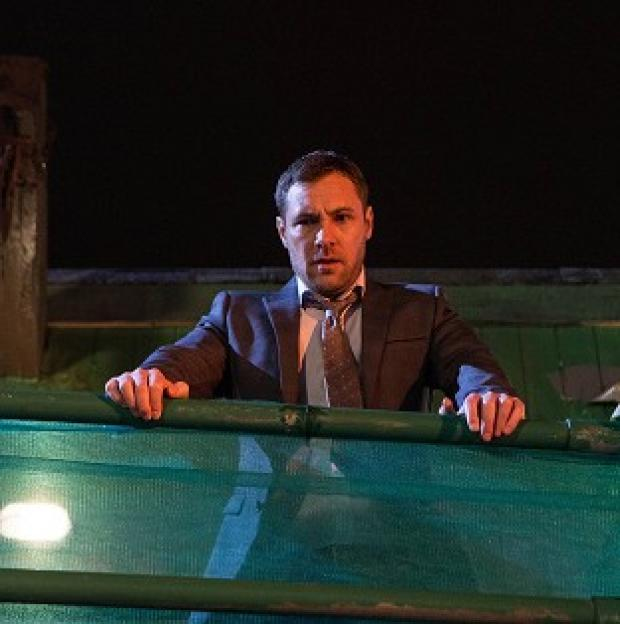 Burnley and Pendle Citizen: ITV handout photo of Coronation Street killer Rob Donovan played by Marc Baylis, as he looks down on the body of barmaid Tina McIntyre, played by Michelle Keegan.