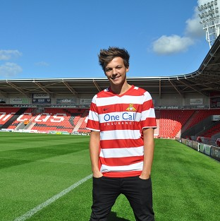 Louis Tomlinson is reported to be involved in a joint bid to buy his hometown football club Doncaster Rovers