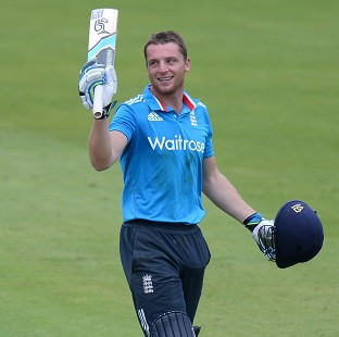 Jos Buttler celebrates his hundred but it did not quite help England to victory