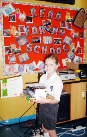 Holly Martin with her 'Read for My School' prizes