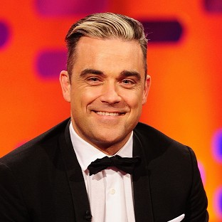 Robbie Williams is finding his stripped-back tour hard work