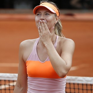 Maria Sharapova, pictured, recovered from a set down to defeat Garbine Muguruza (AP)