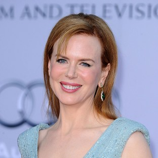 A sickly Nicole Kidman has accepted a Glamour Women Of The Year  award in her pyjamas