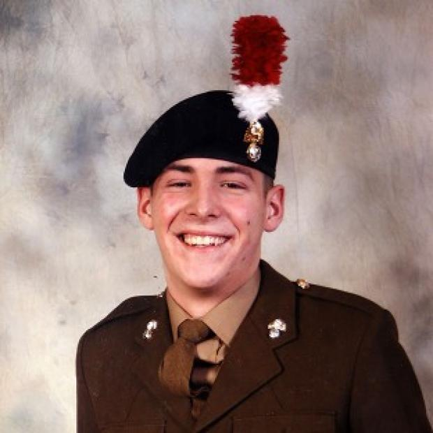 Burnley and Pendle Citizen: Fusilier Lee Rigby was hacked to death by Michael Adebolajo and Michael Adebowale outside Woolwich Barracks on May 22 last year