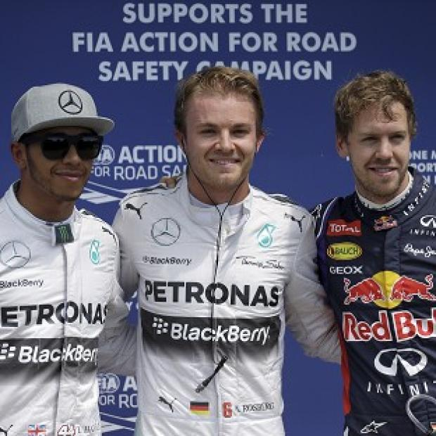 Burnley and Pendle Citizen: Nico Rosberg, centre, got the upper hand on team-mate Lewis Hamilton, right, in qualifying for the Canadian Grand Prix (AP)