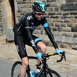 Chris Froome holds a 12 second lead in the Criterium du Dauphine