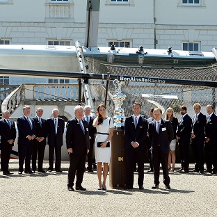 The Duchess of Cambridge with Sir Ben Ainslie, second right, in front of the America's Cup during a visit to the National Maritime Museum